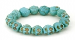 Synthetic Turquoise Howlite Stretchable Bracelet with Skull Beads
